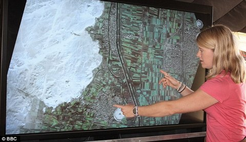 Only the beginning Archaeologist Dr Sarah Parcak points out the site of a buried pyramid on a satellite image.jpg